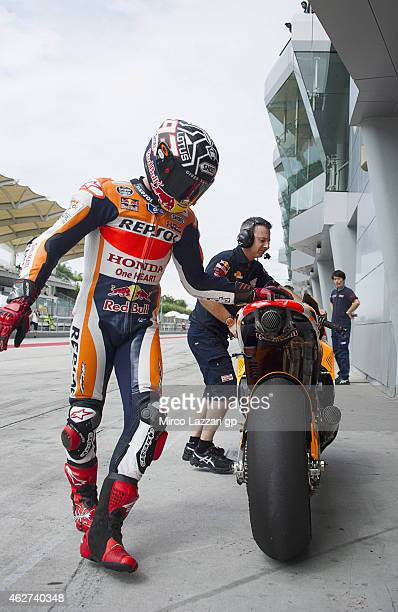 Marc Marquez of Spain and Repsol Honda Team returns in box during day one of the MotoGP tests at Sepang Circuit Sepang Circuit on February 4 2015 in...