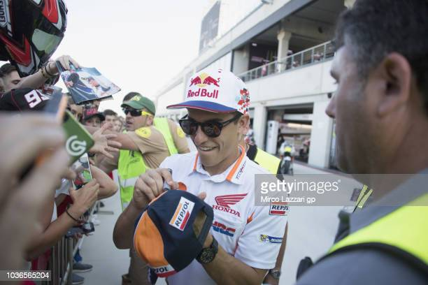 Marc Marquez of Spain and Repsol Honda Team signs autographs for fans during the pit walk during the MotoGP of Aragon Previews at Motorland Aragon...