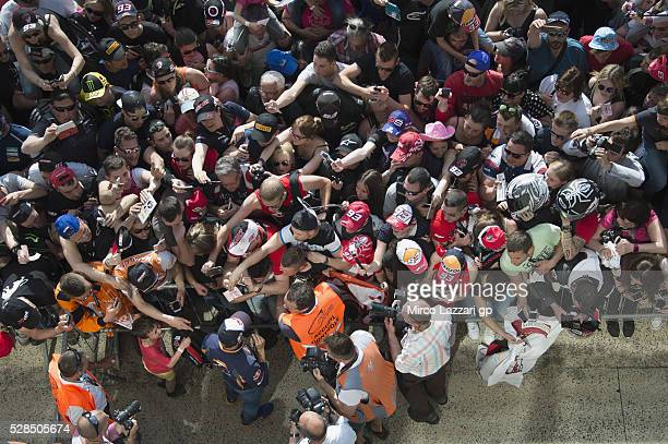 Marc Marquez of Spain and Repsol Honda Team signs autographs for fans in pit during the MotoGp of France Press Conference on May 5 2016 in Le Mans...