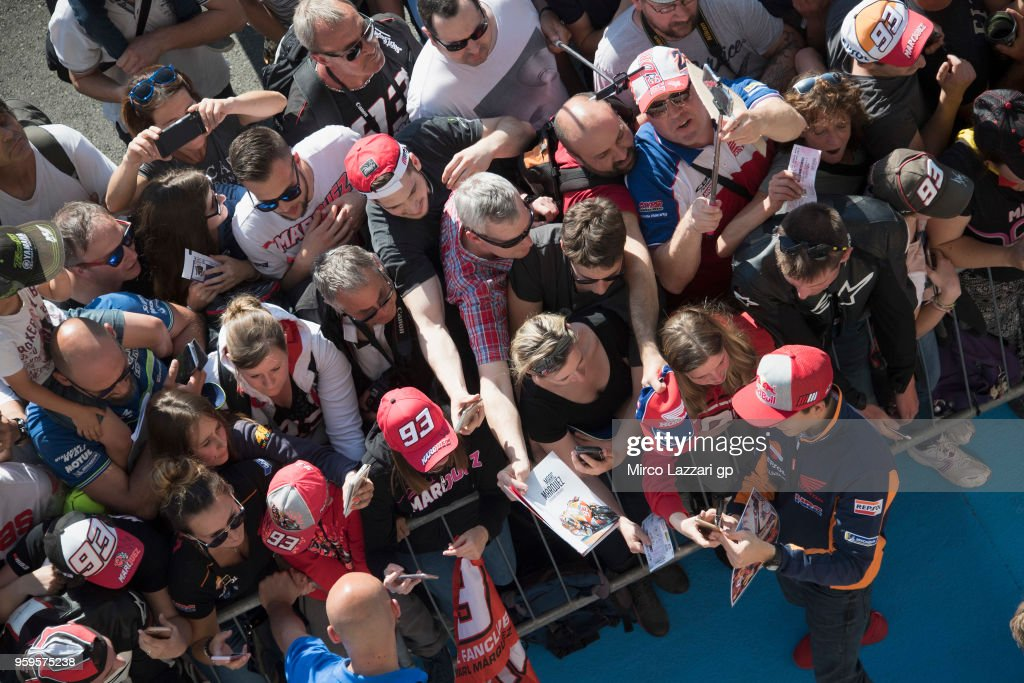 Marc Marquez of Spain and Repsol Honda Team signs autographs for fans in pit during the MotoGp of France - Previews on May 17, 2018 in Le Mans, France.