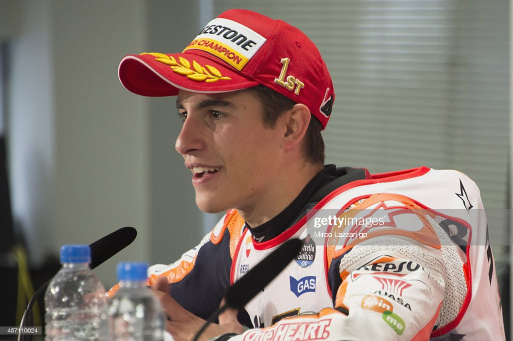 Marc Marquez of Spain and Repsol Honda Team speaks during the press conference and celebrates the victory in the MotoGP championship at the end of the MotoGP race during the MotoGP Of Japan - Race at Twin Ring Motegi on October 12, 2014 in Motegi, Japan.
