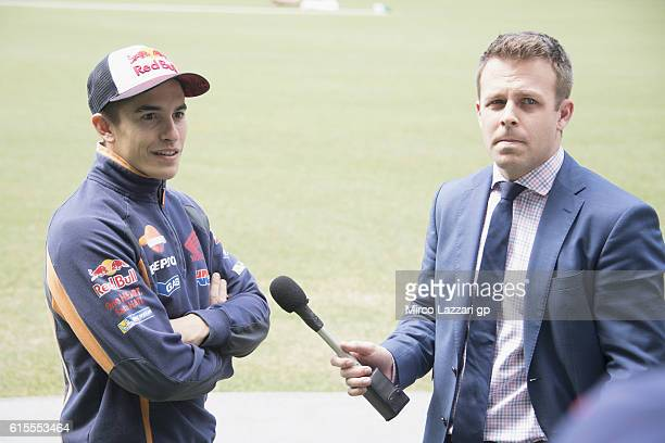 Marc Marquez of Spain and Repsol Honda Team speaks with Australian TV speaker during the preevent in Melbourne Cricket Ground during the MotoGP of...