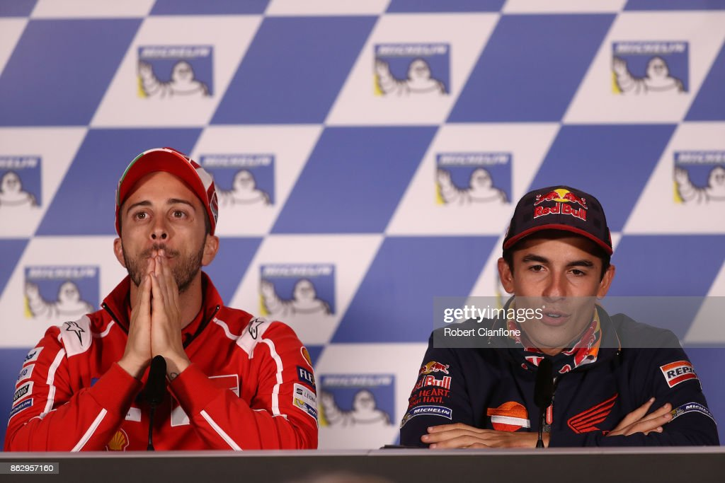 Marc Marquez of Spain and rider of the #93 REPSOL HONDA TEAM Honda speaks to the media as Andrea Dovizioso of Italy and rider of the #4 Ducati Team Ducati listens during a press conference ahead of the 2017 MotoGP of Australia at Phillip Island Grand Prix Circuit on October 19, 2017 in Phillip Island, Australia.