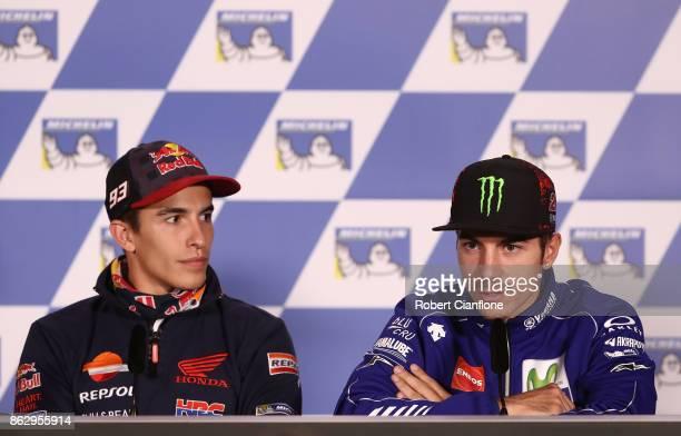 Marc Marquez of Spain and rider of the REPSOL HONDA TEAM Honda listens to Maverick Vinales of Spain and rider of the MOVISTAR YAMAHA MotoGP Yamaha...