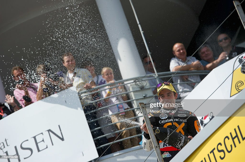 Marc Marquez of Spain and Team Catalunya Caixa Repsol celebrates the victory on the podium and sprays champagne at the end of the Moto2 race of the MotoGp of Germany at Sachsenring Circuit on July 8, 2012 in Hohenstein-Ernstthal, Germany.