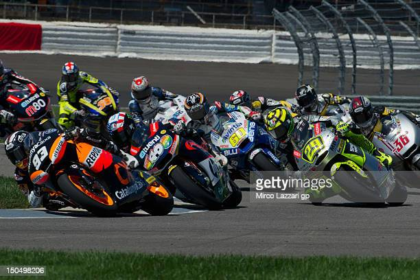 Marc Marquez of Spain and Team Catalunya Caixa Repsol leads the field during the Moto2 race during the Red Bull Indianapolis Grand Prix at...