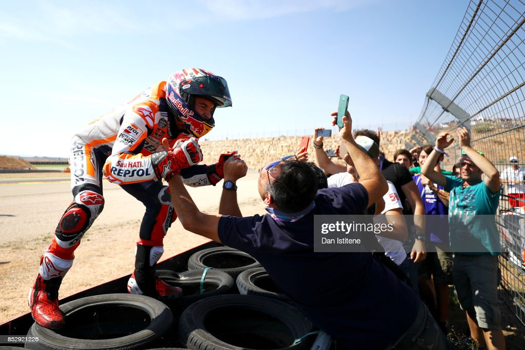 Marc Marquez of Spain and the Repsol Honda Team celebrates victory with his fans by the side of the track after the MotoGP of Aragon at Motorland Aragon Circuit on September 24, 2017 in Alcaniz, Spain.