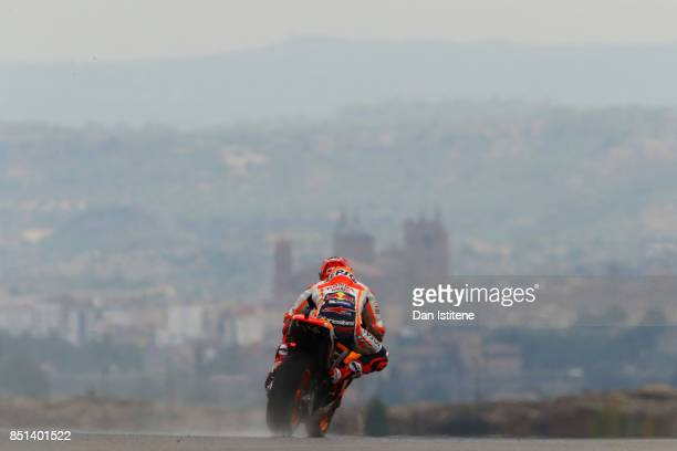 Marc Marquez of Spain and the Repsol Honda Team rides backdropped by the Santa Maria la Mayor church in the nearby town of Alcaniz during practice...