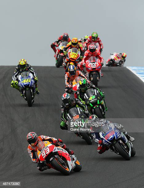 Marc Marquez of Spain rides the Repsol Honda Team Honda leads the field over the hill during the 2014 MotoGP of Australia at Phillip Island Grand...