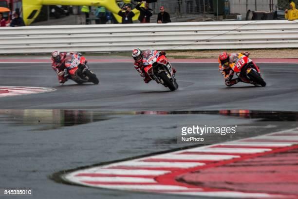 Marc MARQUEZ SPA Repsol Honda Team Andrea DOVIZIOSO ITA Ducati TeamDUCATI Jorge LORENZO SPA Ducati Teamduring MotoGP race in Marco Simoncelli Circuit...