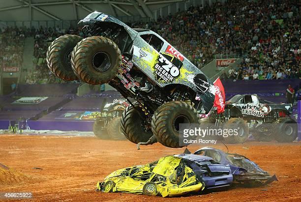 Marc McDonald driving Big Bash League jumps over cars during Monster Jam at AAMI Park on October 4 2014 in Melbourne Australia