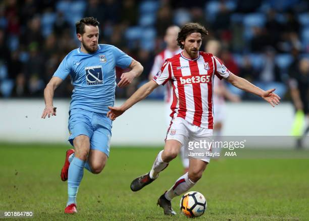 Marc McNulty of Coventry City and Joe Allen of Stoke City during The Emirates FA Cup Third match between Coventry City and Stoke City at Ricoh Arena...