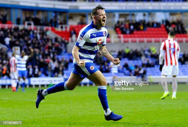 Marc McNulty of Reading celebrates scoring his team's first goal during the Sky Bet Championship match between Reading and Stoke City at Madejski...