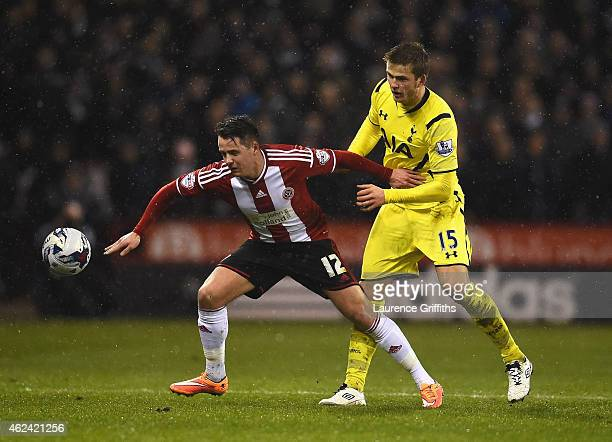 Marc McNulty of Sheffield United is closed down by Eric Dier of Tottenham Hotspur during the Capital One Cup SemiFinal Second Leg match between...