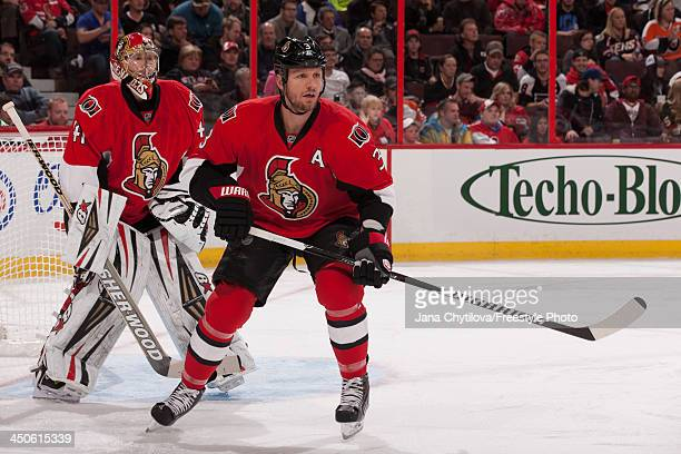 Marc Methot and Craig Anderson of the Ottawa Senators defend the net during an NHL game against the Philadelphia Flyers at Canadian Tire Centre on...