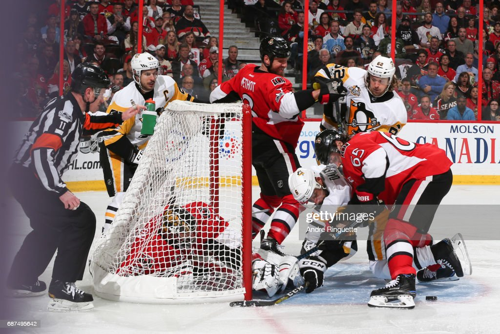 Marc Methot #3 and Erik Karlsson #65 of the Ottawa Senators battle for a loose puck with Trevor Daley #6, Carl Hagelin #62 and Sidney Crosby #87 of the Pittsburgh Penguins in front of teammate Craig Anderson in Game Six of the Eastern Conference Final during the 2017 NHL Stanley Cup Playoffs at Canadian Tire Centre on May 23, 2017 in Ottawa, Ontario, Canada.