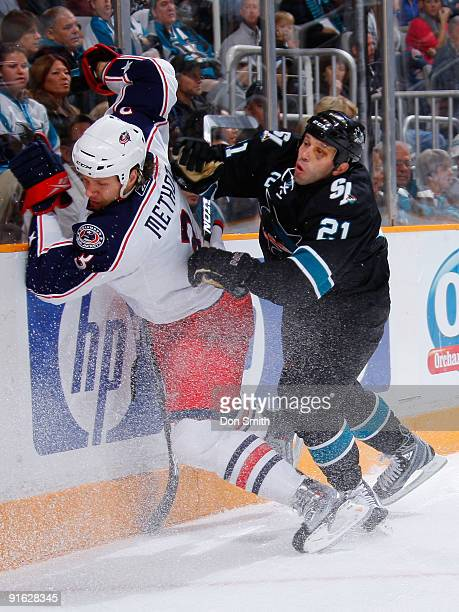 Marc Methot of the Columbus Blue Jackets and Scott Nichol of the San Jose Sharks fight for position against the boards during an NHL game on October...