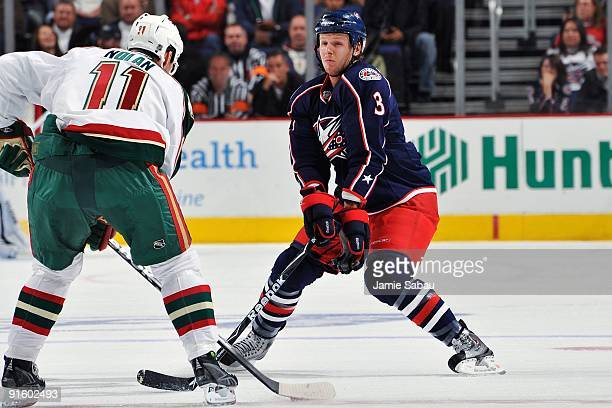 Marc Methot of the Columbus Blue Jackets defends against Owen Nolan of the Minnesota Wild on October 3 2009 at Nationwide Arena in Columbus Ohio