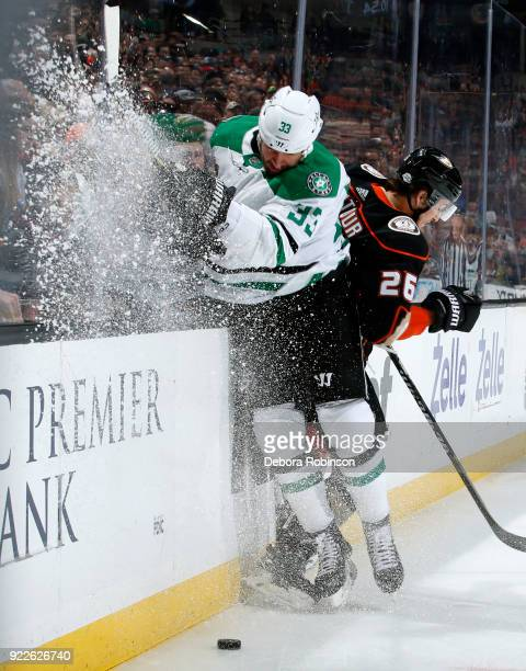 Marc Methot of the Dallas Stars battles for the puck against Brandon Montour of the Anaheim Ducks during the game on February 21 2018 at Honda Center...