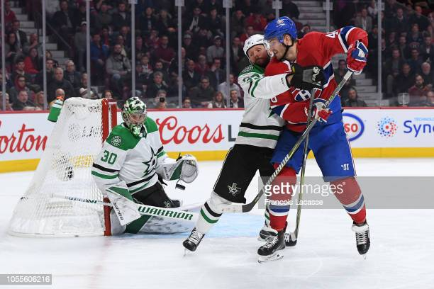 Marc Methot of the Dallas Stars defends against Joel Armia of the Montreal Canadiens in the NHL game at the Bell Centre on October 30 2018 in...