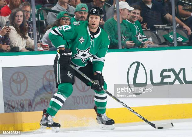 Marc Methot of the Dallas Stars handles the puck against the Detroit Red Wings at the American Airlines Center on October 10 2017 in Dallas Texas