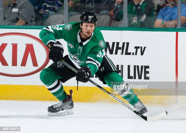 Marc Methot of the Dallas Stars handles the puck against the Vegas Golden Knights at the American Airlines Center on October 6 2017 in Dallas Texas