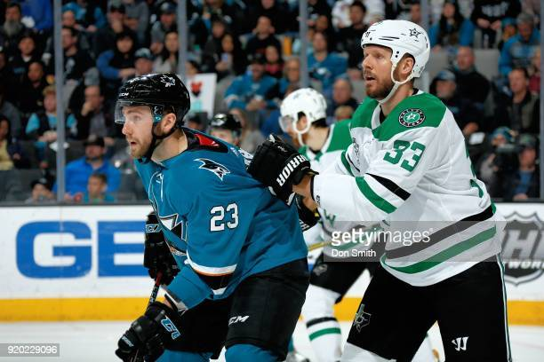 Marc Methot of the Dallas Stars holds onto the jersey of Barclay Goodrow of the San Jose Sharks at SAP Center on February 18 2018 in San Jose...