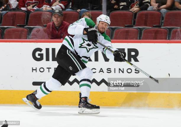 Marc Methot of the Dallas Stars shoots the puck up ice against the Arizona Coyotes at Gila River Arena on October 19 2017 in Glendale Arizona