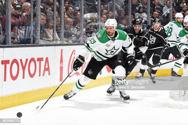 Marc Methot of the Dallas Stars skates after the puck against Torrey Mitchell of the Los Angeles Kings at STAPLES Center on February 22 2018 in Los...