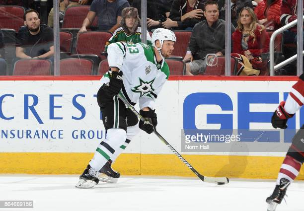 Marc Methot of the Dallas Stars skates the puck up ice against the Arizona Coyotes at Gila River Arena on October 19 2017 in Glendale Arizona