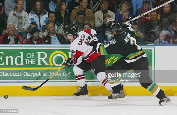 Marc Methot of the London Knights defends the play of Daniel Carcillo of the Mississauga IceDogs during the Ontario Hockey League game at John Labatt...