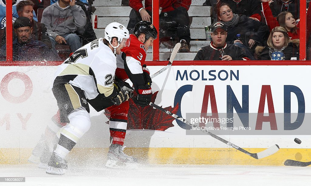 Marc Methot #3 of the Ottawa Senators battles along the boards for the loose puck against Matt Cooke #24 of the Pittsburgh Penguins during an NHL game at Scotiabank Place on January 27, 2013 in Ottawa, Ontario, Canada.
