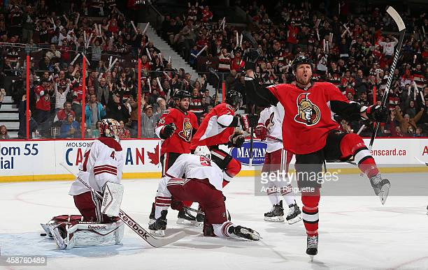 Marc Methot of the Ottawa Senators celebrates his first period power-play goal against Mike Smith and Connor Murphy of the Phoenix Coyotes with...