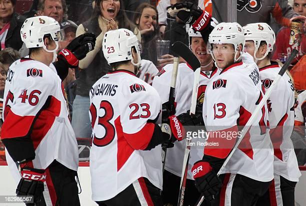 Marc Methot of the Ottawa Senators celebrates his second-period goal against the Philadelphia Flyers with teammates Patrick Wiercioch, Kaspars...