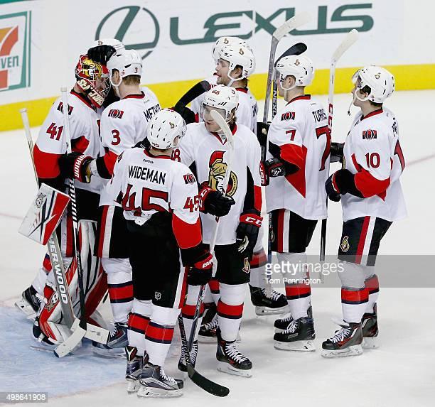 Marc Methot of the Ottawa Senators celebrates with Craig Anderson of the Ottawa Senators after the Senators beat the Dallas Stars 74 at American...
