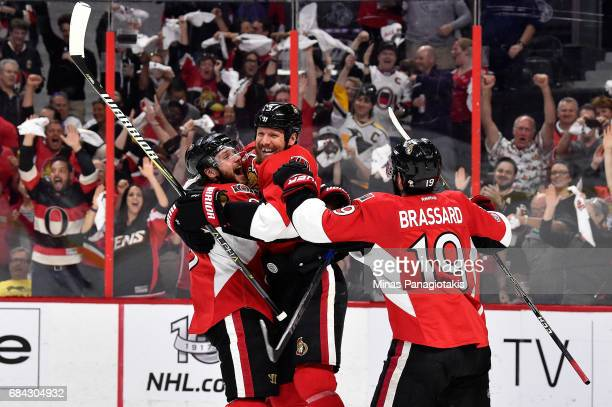 Marc Methot of the Ottawa Senators celebrates with his teammates after scoring a goal against MarcAndre Fleury of the Pittsburgh Penguins during the...