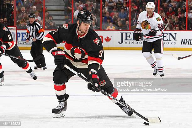 Marc Methot of the Ottawa Senators controls the puck against the Chicago Blackhawks at Canadian Tire Centre on March 28 2014 in Ottawa Ontario Canada