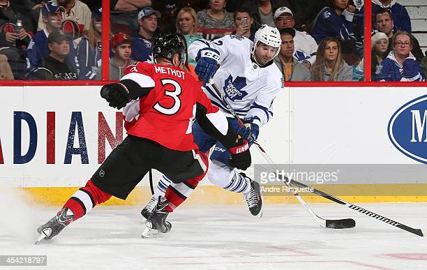 Marc Methot of the Ottawa Senators defends against Nazem Kadri of the Toronto Maple Leafs at Canadian Tire Centre on December 7 2013 in Ottawa...