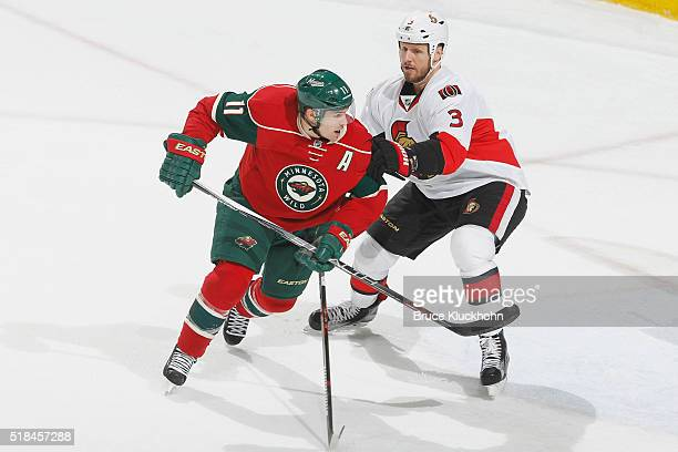 Marc Methot of the Ottawa Senators defends Zach Parise of the Minnesota Wild during the game on March 31 2016 at the Xcel Energy Center in St Paul...