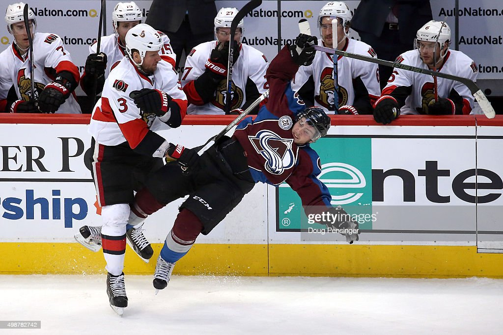 Marc Methot #3 of the Ottawa Senators is penalized for interference for this hit on Matt Duchene #9 of the Colorado Avalanche in the third period at Pepsi Center on November 25, 2015 in Denver, Colorado. The Senators defeated the Avalanche 5-3.