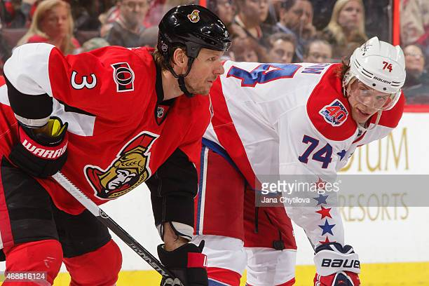 Marc Methot of the Ottawa Senators prepares for a faceoff against John Carlson of the Washington Capitals at Canadian Tire Centre on April 4 2015 in...