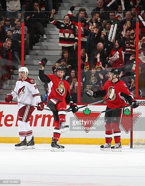 Marc Methot of the Ottawa Senators pumps his fist to celebrate his second period goal with teammate Milan Michalek as Rostislav Klesla of the Phoenix...