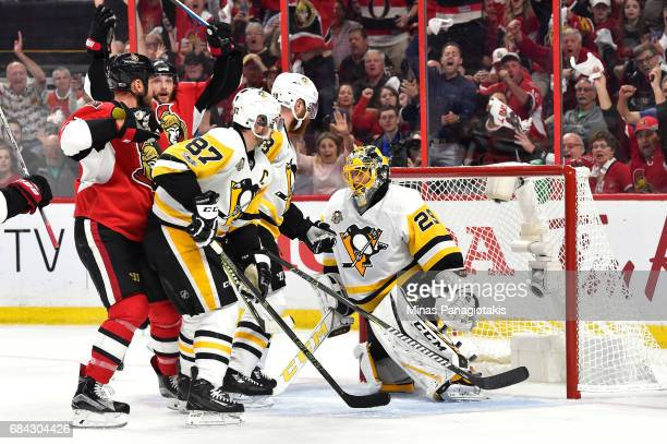 Marc Methot of the Ottawa Senators scores a goal against MarcAndre Fleury of the Pittsburgh Penguins during the first period in Game Three of the...