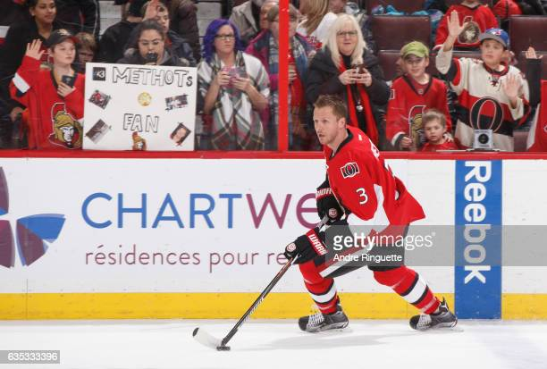 Marc Methot of the Ottawa Senators skates in front of guests holding a sign proclaiming to be his number ones fans during warmup prior to a game...