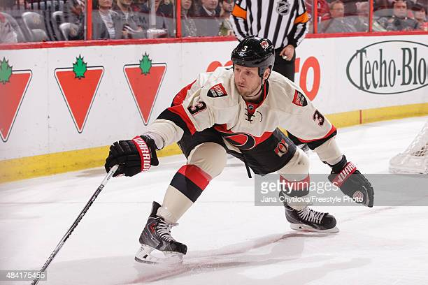 Marc Methot of the Ottawa Senators uses his stick as he defends the net against the Montreal Canadiens during an NHL game at Canadian Tire Centre on...
