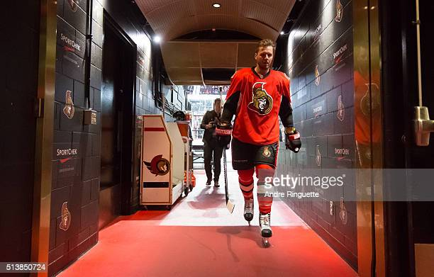 Marc Methot of the Ottawa Senators walks down the players' tunnel after warmup prior to a game against the St Louis Blues at Canadian Tire Centre on...