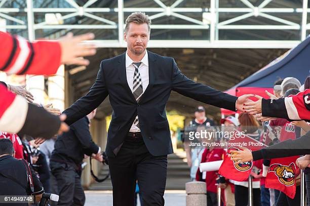 Marc Methot of the Ottawa Senators walks the red carpet prior to their home opener against the Toronto Maple Leafs at Canadian Tire Centre on October...