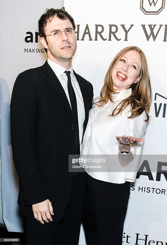 Marc Mezvinsky (L) and Chelsea Clinton attend the 2015 amfAR New York Gala at Cipriani Wall Street on February 11, 2015 in New York City.
