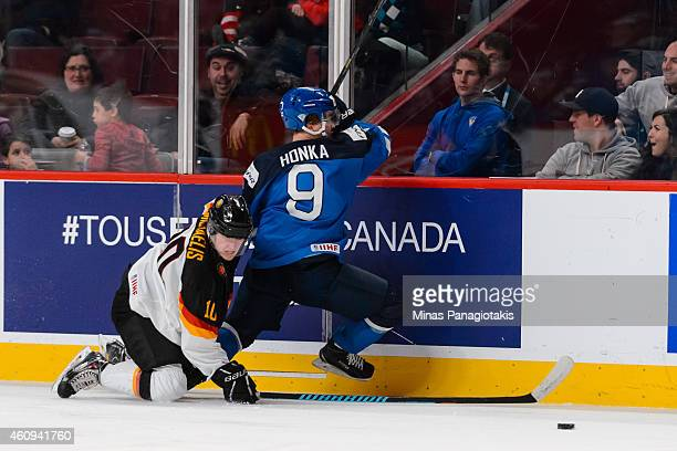 Marc Michaelis of Team Germany falls behind Julius Honka of Team Finland in a preliminary round game during the 2015 IIHF World Junior Hockey...