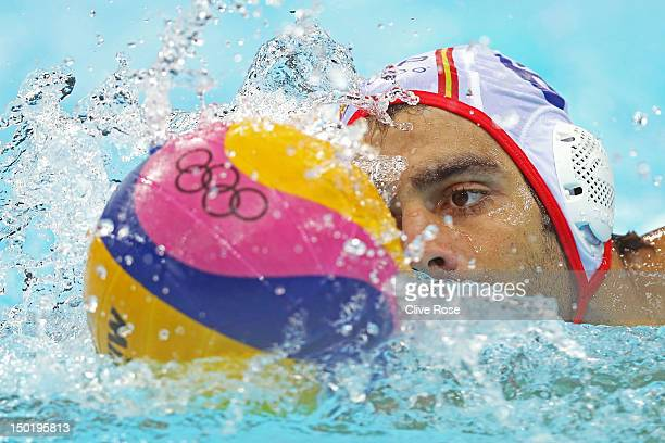Marc Minguell Alferez of Spain competes in the Men's Classification 5th6th place match between Spain and Hungary on Day 16 of the London 2012 Olympic...